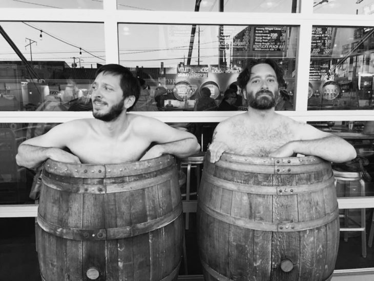 Chris & Andrew in barrels at Cascade Brewing
